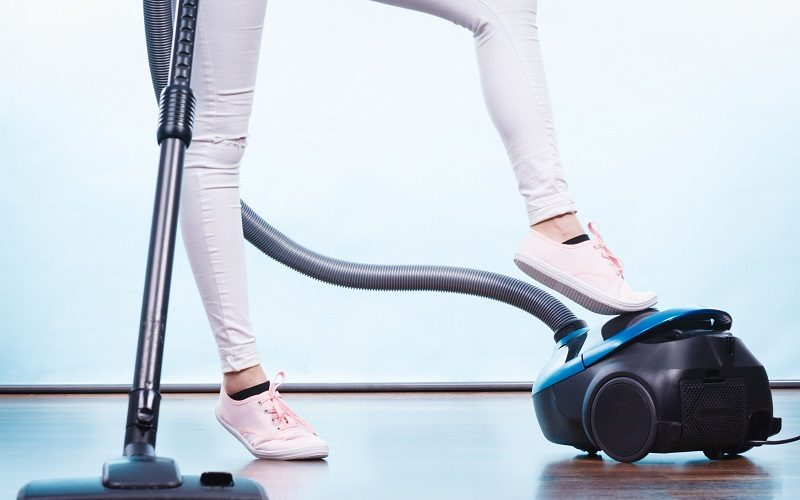 woman-legs-and-vacuum-cleaner-royalty-free-image-945451790-1556543934
