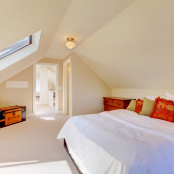 bright-clean-dormer-loft-conversion-bedroom-in-the-decent-size-home-with-beige-carpet